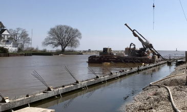 Michels worked from land and from barges to remove 800 feet of deteriorating timber and concrete seawall along the Kewaunee River in Harbor Park before replacing it with 800 feet of anchored steel sheet pile bulkhead.
