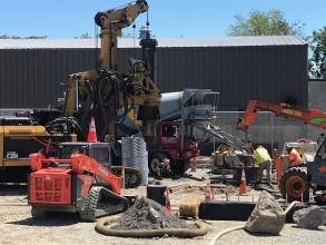 Michels Power, Inc. installed 39 drilled shafts and 120 helical piles for a substation foundation.