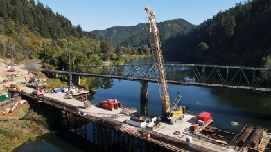 Michels installed large 8 foot diameter drilled shafts with rock sockets in 15,000 psi sandstone, soldier pile installation, permanent ground anchors, and lagging installation in Scottsburg, OR on the Umpqua River.